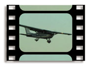 Cessna 182 with flaps down for landing